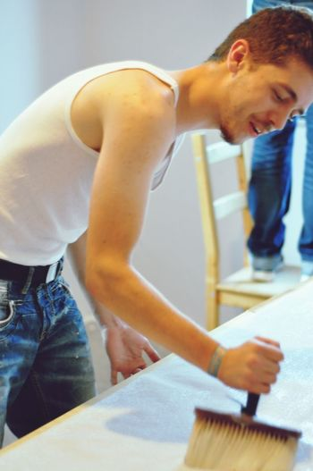 EyeEm Selects Indoors  Young Adult Casual Clothing Standing Working Real People Occupation One Person Young Women Men Human Hand Day People Tapezieren Working Paperhanging