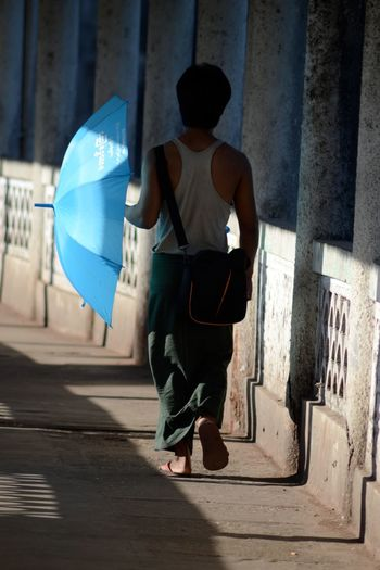 Yangoon Blue Architecture Streetphotography Urbanphotography Urbanexploration Street Photography Streetphoto Travel Photography Umbrella Umbrellas Up Close Street Photography Travel The Street Photographer - 2016 EyeEm Awards People And Places.