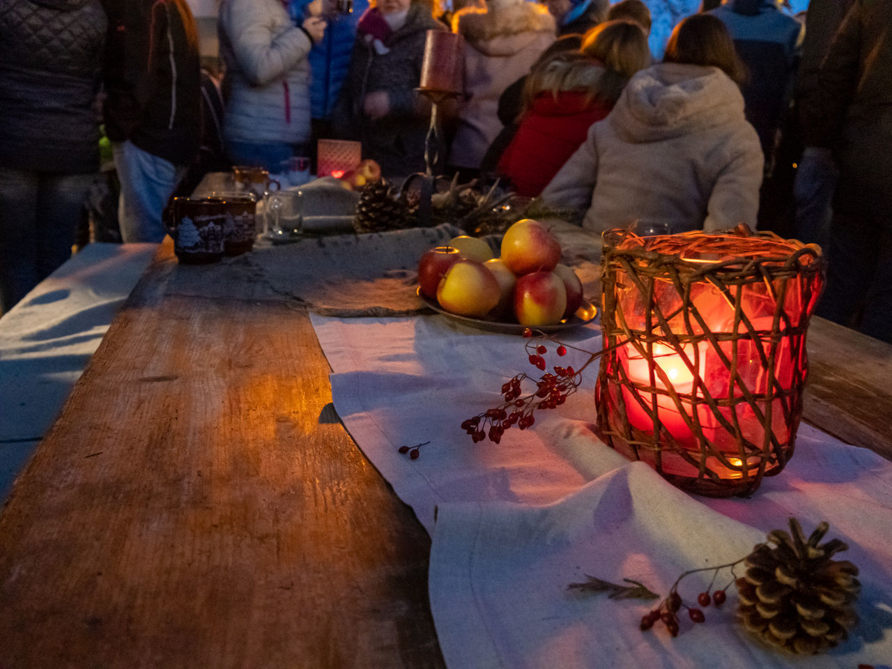 food and drink, group of people, food, real people, fruit, wellbeing, healthy eating, freshness, table, illuminated, religion, men, people, candle, market, incidental people, indoors, spirituality, group