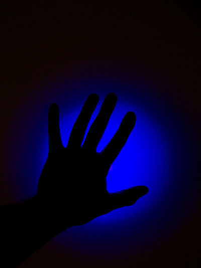 Human Hand Hand Human Body Part Finger Blue Body Part Human Finger Silhouette Real People People Personal Perspective Unrecognizable Person Indoors  Night Lifestyles Leisure Activity Illuminated Studio Shot Close-up