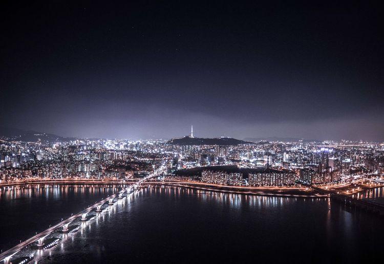 Illuminated buildings in city at night, seoul.