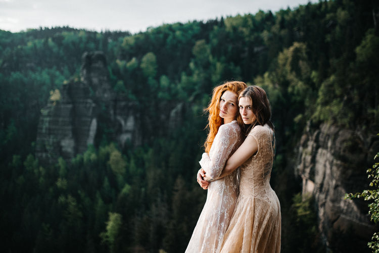 Morgentraum Women Adult Tree Standing Young Adult Emotion Event Wedding Clothing Hairstyle Three Quarter Length Fashion Newlywed Plant Celebration Young Women Togetherness Couple - Relationship Dress Hair Outdoors Rock - Object Cliff EyeEmNewHere EyeEm Best Shots Capture Tomorrow 2018 In One Photograph #NotYourCliche Love Letter International Women's Day 2019