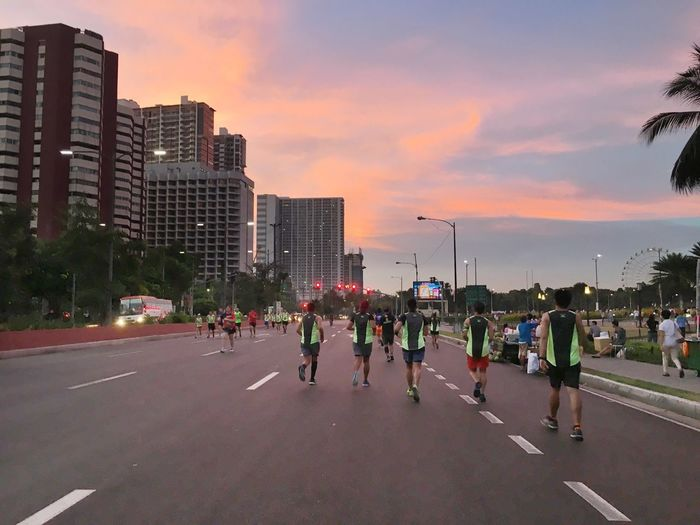 Run as far as you can. This is a typical Sunday morning when roads are closed due to marathon. These guys are ahead of me. This means I have to stop taking pictures and catch up. Sunrise People Running Large Group Of People City Built Structure Architecture Skyscraper People Stories From The City