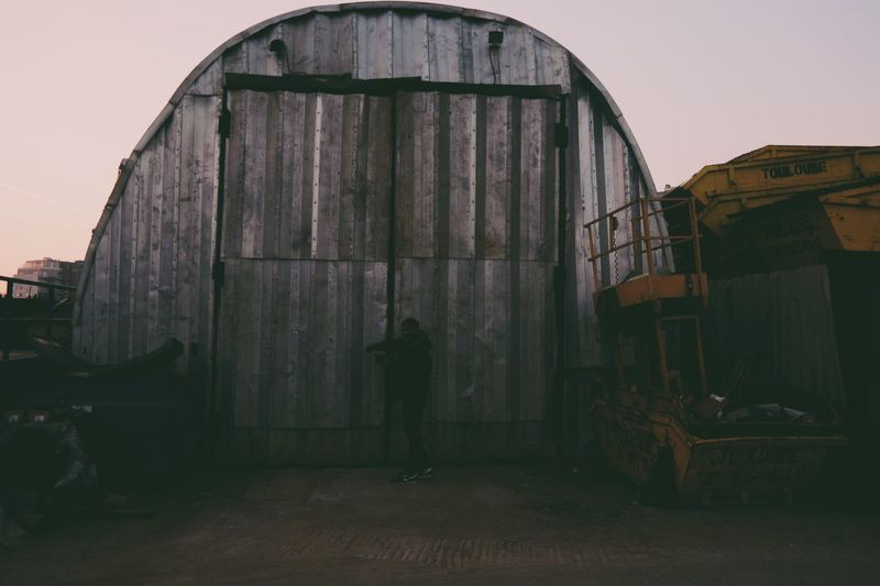 Man in front of built structure against sky