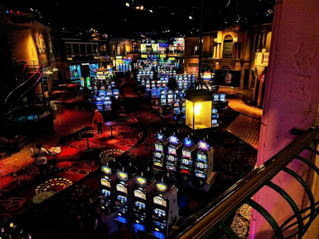 lots of slot machines, not so much people Multi Colored Indoors  Illuminated EyeEm Gallery Let's Do It Chic! Eyem Gallery Different Yet The Same What I See Las Vegas Casino Taking Photos Slot Machines Gambling FlashingLights Indoor Photography Vegas  Pattern
