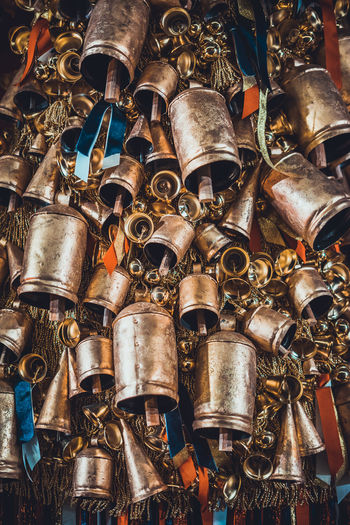 Close-up of metallic bells for sale at market
