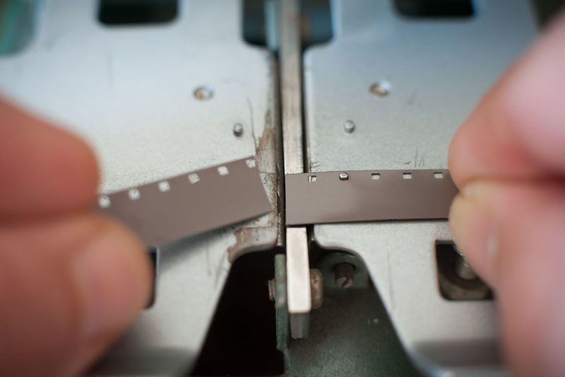 Editing splicer detail Cinema Close-up Connection Detail Editing Film Filmstrip App MOVIE Part Of Post Production Selective Focus Splicer Super 8