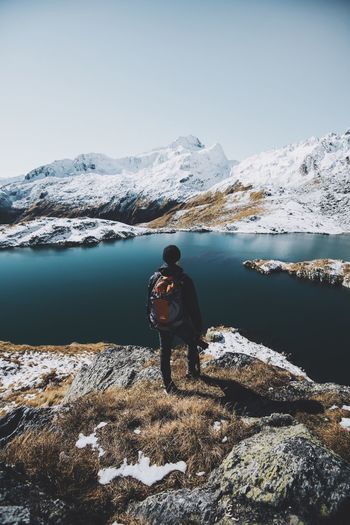 mood Nature Leisure Activity Beauty In Nature Photography Themes One Person Mountain Snow Hiking Real People Lifestyles Backpack Water Day Scenics Outdoors Sky Adventure Men Lake Camera - Photographic Equipment