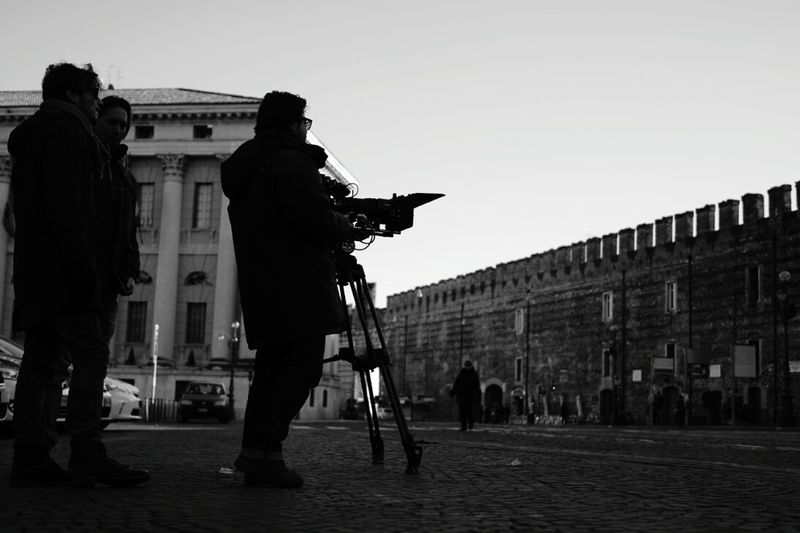 Silhouette Of Man With Video Camera