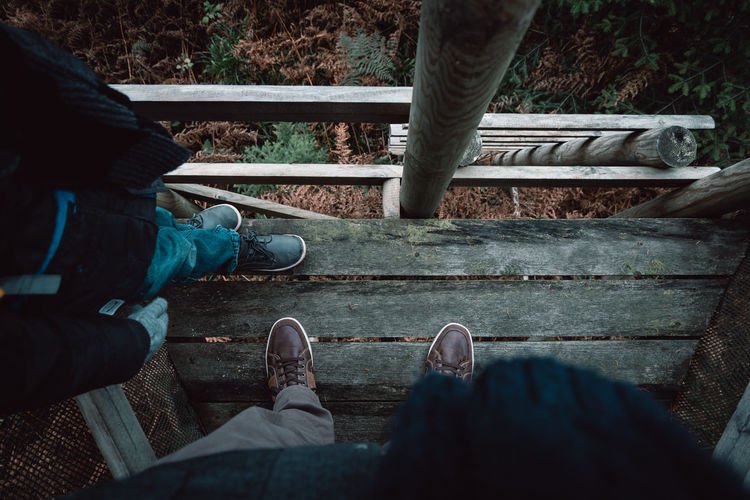 Low Section Of People Standing On Footbridge