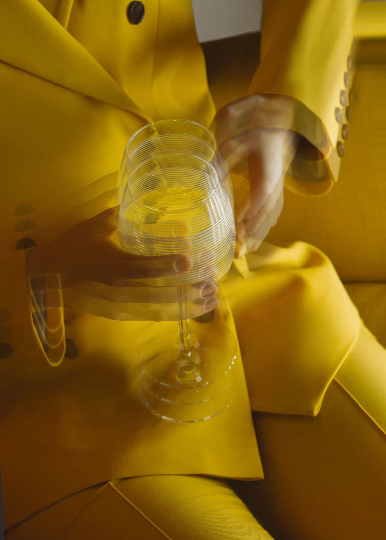 Blurred motion of woman holding wineglass
