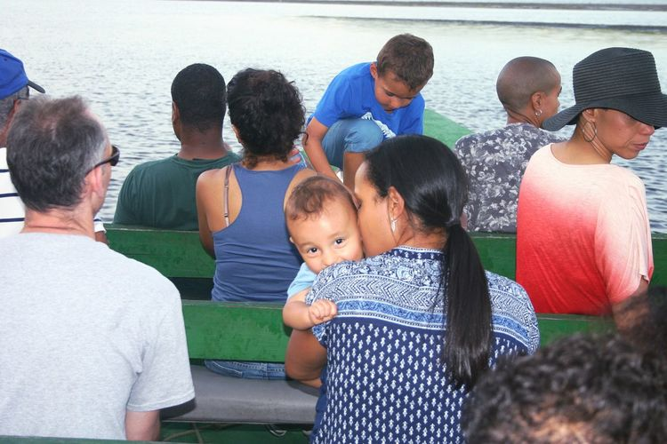 Mother cuddling her baby on the boatride in the swamp Boat Ride Mothers Love Trinidad And Tobago Caroni Swamp Bird Sanctuary Feel The Journey