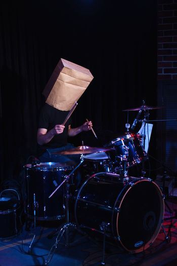 man with paper bag on his head, play drums Bag On Head Hipster Music Musical Instrument Arts Culture And Entertainment Musical Equipment Musician Performance Real People Men Drum Drum - Percussion Instrument Rock Music Artist Playing Skill  One Person