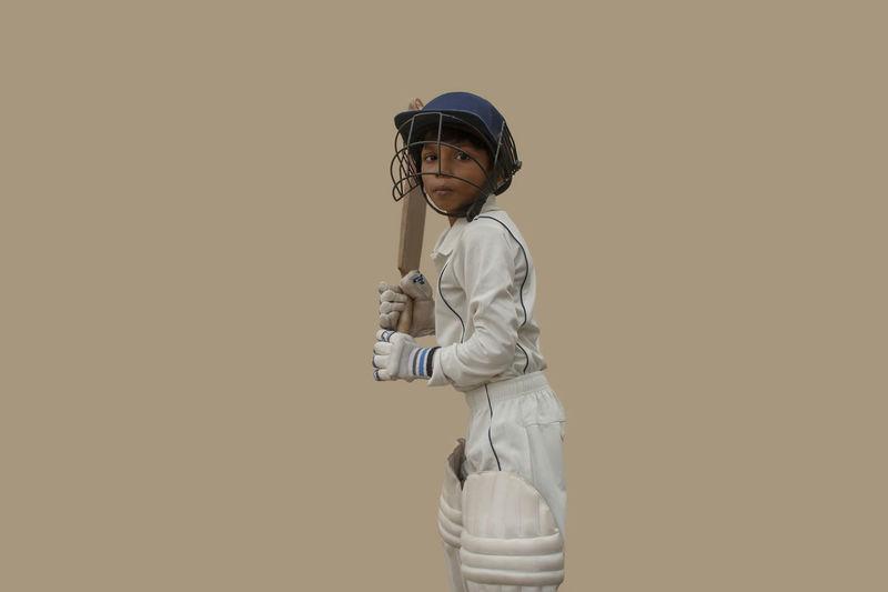 Full length of boy standing against white background