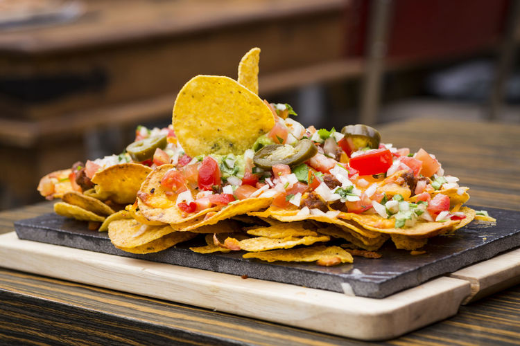 Close-up of nachos served on table