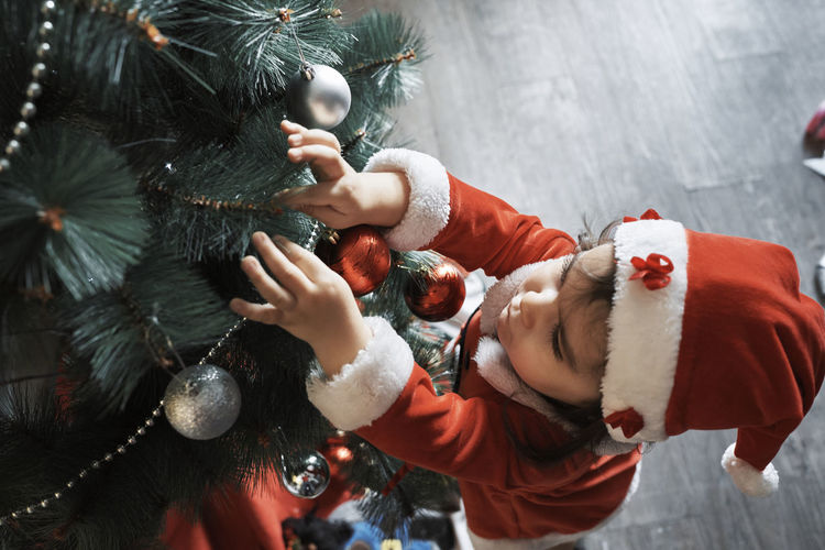 High angle view of woman holding christmas decorations