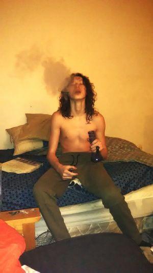 Smokin Smokin Mary Jane Bud Marijuana Sitting Shirtless Full Length Portrait