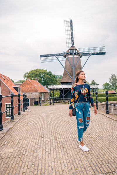 Netherlands Adult Architecture Building Exterior Built Structure Casual Clothing Day Dutch Freisland Friesland Town Front View Full Length Hairstyle Leisure Activity Lifestyles Nature One Person Outdoors Real People Sky Sloterdijk Smiling The Way Forward Town Women Young Adult Young Women