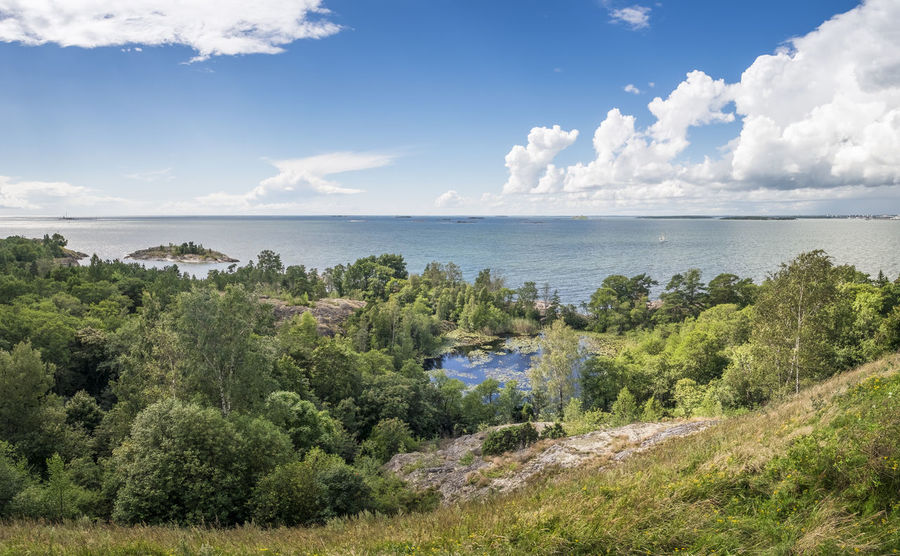 Scenic landscape against blue sky in historic island Vallisaari, Helsinki, Finland. Bay Of Water Beach Blue Blue Sky City Day Green Historic History Horizon Over Water Landscape Nature No People Outdoors Scenics Sea Summer Summertime Sunny Tourism Trees Vallisaari Vegetation Water