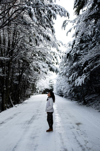 Beauty In Nature Cold Temperature Covering Diminishing Perspective Direction Full Length Landscape Leisure Activity Lifestyles Nature One Person Outdoors Plant Real People Rear View Road Snow Snowcapped Mountain The Way Forward Transportation Tree Warm Clothing Winter EyeEmNewHere