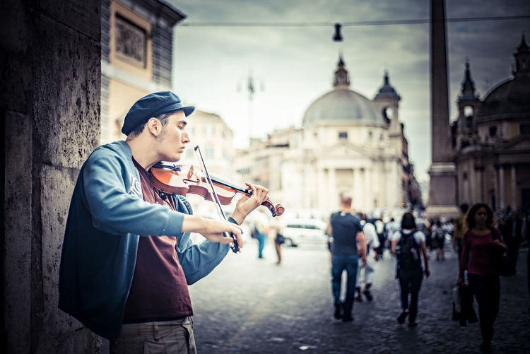 Man playing violin in city