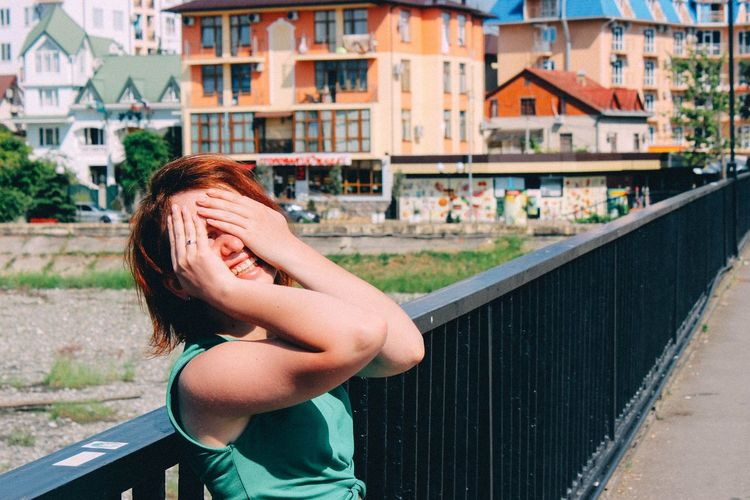 happiness EyeEm Selects City Young Women Women Architecture Building Exterior Sky Built Structure Close-up Hiding Hands Covering Eyes Face Redhead Shy Wavy Hair Disappointment Embarrassment