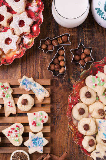 Christmas Cookie Dessert Food And Drink Nuts Ready To Eat Red Shape Standing Bakery Blue Cookie Food Foodphotography Fresh Heart Indoors  Marmelade Milk No People Sweet Table Wood - Material
