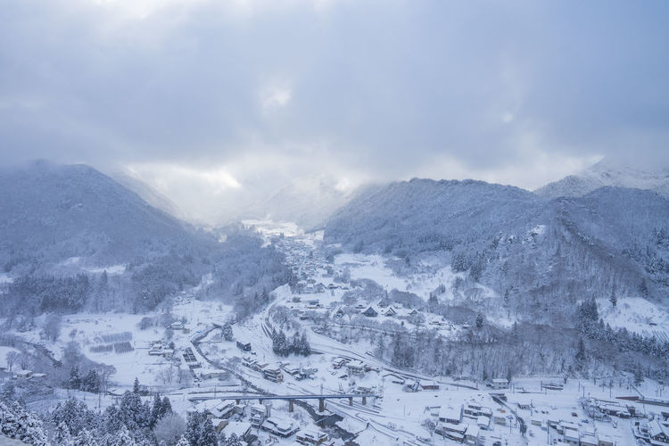 Snow Cold Temperature Mountain Winter Environment Landscape Scenics - Nature Cloud - Sky City Nature Travel Beauty In Nature Journey Sky No People Holiday Trip Mountain Range Travel Destinations Outdoors Range Snowcapped Mountain Snowing Place