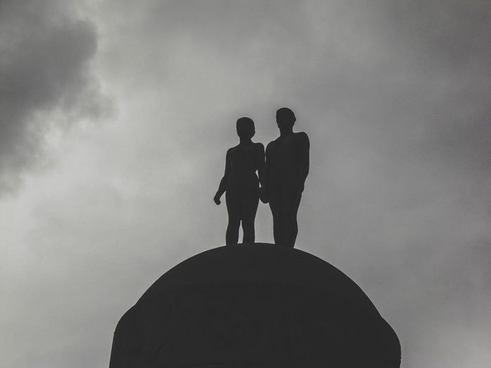 Bonding Cloud - Sky Day Friendship Full Length Leisure Activity Lifestyles Low Angle View Male Likeness Men Nature Outdoors People Real People Silhouette Sky Standing Togetherness Two People Inner Power