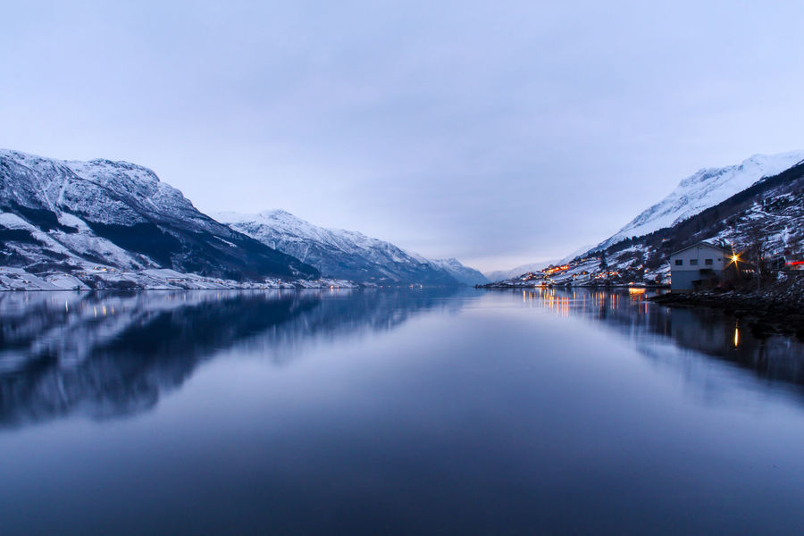 Norway Travel Backpack Beauty In Nature Cold Temperature Idyllic Lake Landscape Mountain Mountain Peak Mountain Range Nature No People Outdoors Reflection Scenics - Nature Sky Snow Snowcapped Mountain Tranquil Scene Tranquility Water Waterfront Winter