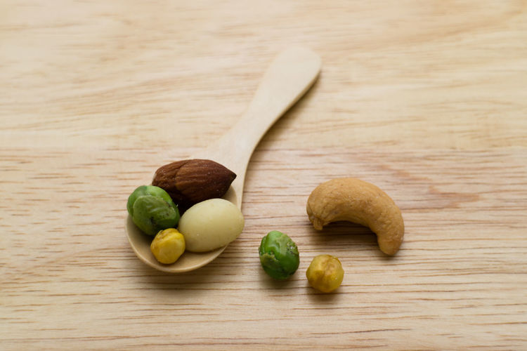 Mixed beans in the wooden spoon Almond Arrangement Beans Close-up Food Freshness Green Beans Green Color Group Of Objects Macadamia Mixed Beans No People Organic Selective Focus Still Life Wood - Material Wooden
