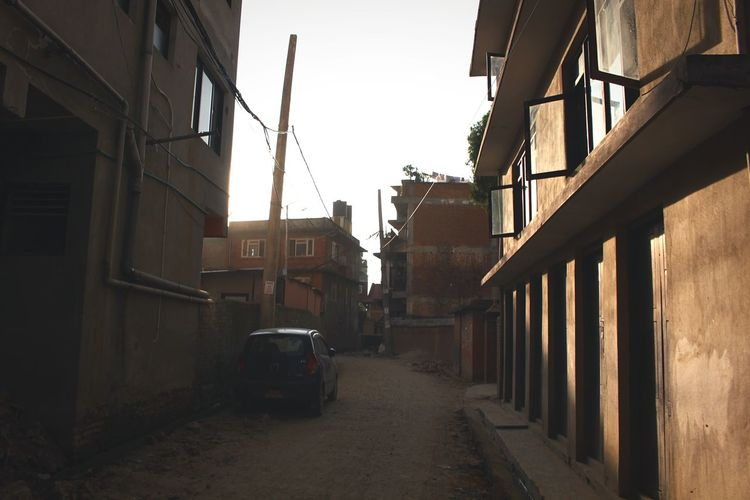 sunset,then people back to own home Sunlight Shadow Light And Shadow Shadow And Light Nepal ASIA Nostalgia Lonely Sand Blick Car Land Vehicle City Outdoors No People Sky Day Street The Way Forward Residential Building House Building Exterior Built Structure Architecture