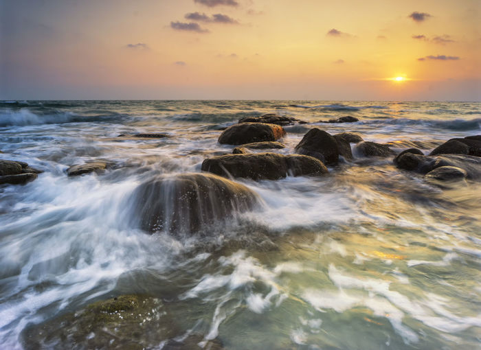 Water Sea Sunset Sky Scenics - Nature Motion Beauty In Nature Rock Horizon Over Water Solid Horizon Land Nature Long Exposure Rock - Object Beach Wave No People Orange Color Outdoors Flowing Water Power In Nature Seascape Sea And Sunset Wave Movement Wave Motion Waterfront Wave And Rock