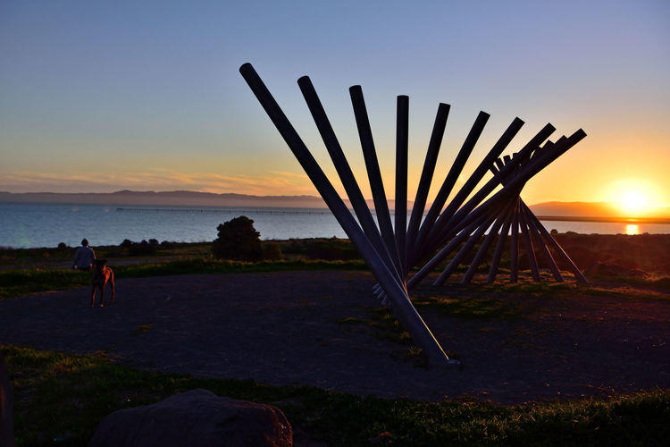 Sunset @ Oyster Bay Pt 7 San Leandro, Ca. Stainless Steel Sculpture Rising Wave 16 Poles Artist: Roger Berry All About Angles Sunset Sunset Silhouettes Sunset_collection Bench Sunset Photography Landscape_Collection Landscape_photography Hilltop Landscape Nature Beauty In Nature Nature_collection San Francisco Bay Tranquility Dog Boulder Sun Above The Horizon
