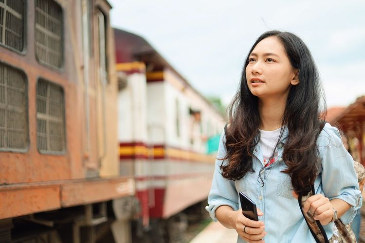 Rail Transportation Young Adult Lifestyles Young Women Standing One Person Long Hair Mode Of Transportation Public Transportation Train Transportation Hairstyle Beauty Focus On Foreground Train - Vehicle Real People Hair Women Casual Clothing Beautiful Woman Track Outdoors