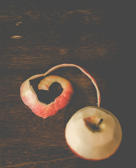 Love heart made from apple peeled skin Apple Close-up Couple Creativity Dark Darkness Dead Ringers Deliberate Care Design Freshness Friend Healthy Eating In Love Join Love Matte Organic Peeling Photography Ready To Eat Shell Table