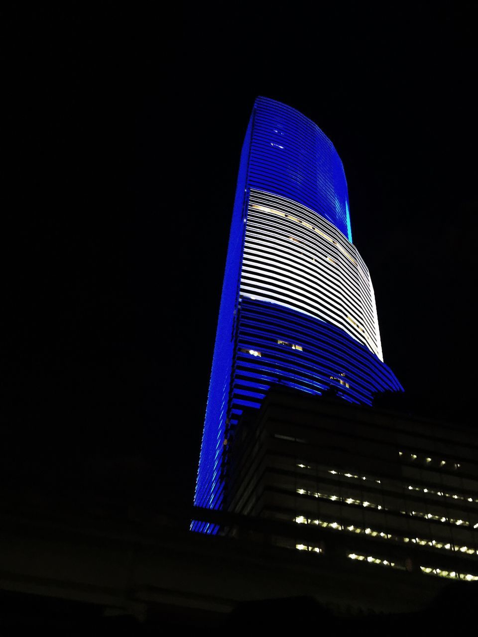 night, modern, illuminated, architecture, low angle view, building exterior, built structure, skyscraper, city, outdoors, no people, sky