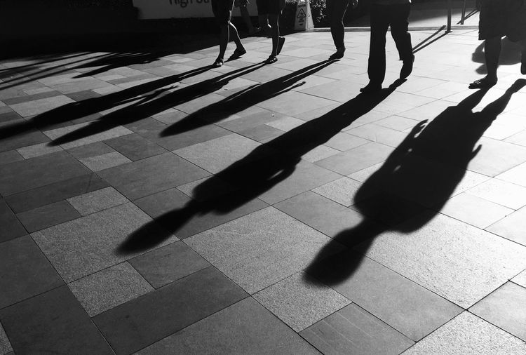 People cast shadows as they walk in Fort Bonifacio High Street in Taguig City, metropolitan Manila. Shadow Low Section Walking Person Sunlight Lifestyles Leisure Activity Group Of People Focus On Shadow Taguig BonifacioGlobalCity Bonifacio Global City Philippines
