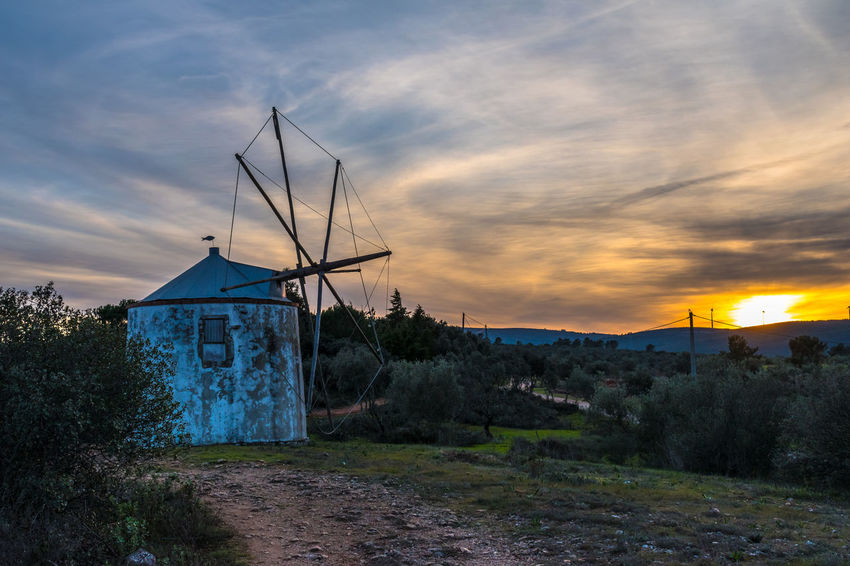 Architecture Beauty In Nature Building Exterior Built Structure Day Landscape Nature No People Outdoors Sky Sunset Traditional Windmill Windmill Colour Your Horizn