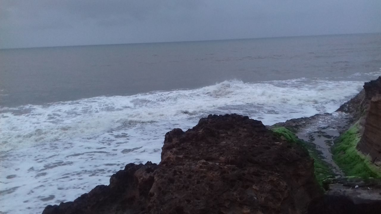 sea, water, horizon over water, nature, beauty in nature, rock - object, scenics, wave, tranquil scene, outdoors, no people, sky, tranquility, day, beach