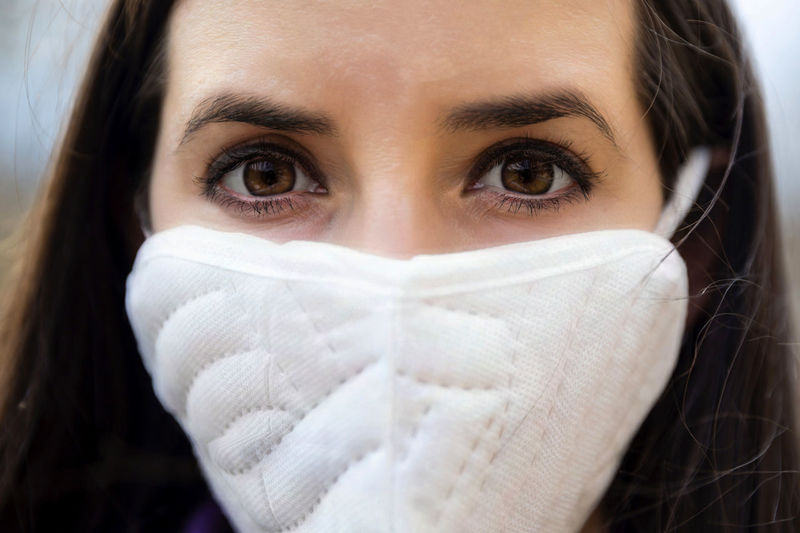 Close-up portrait of teenage girl covering face