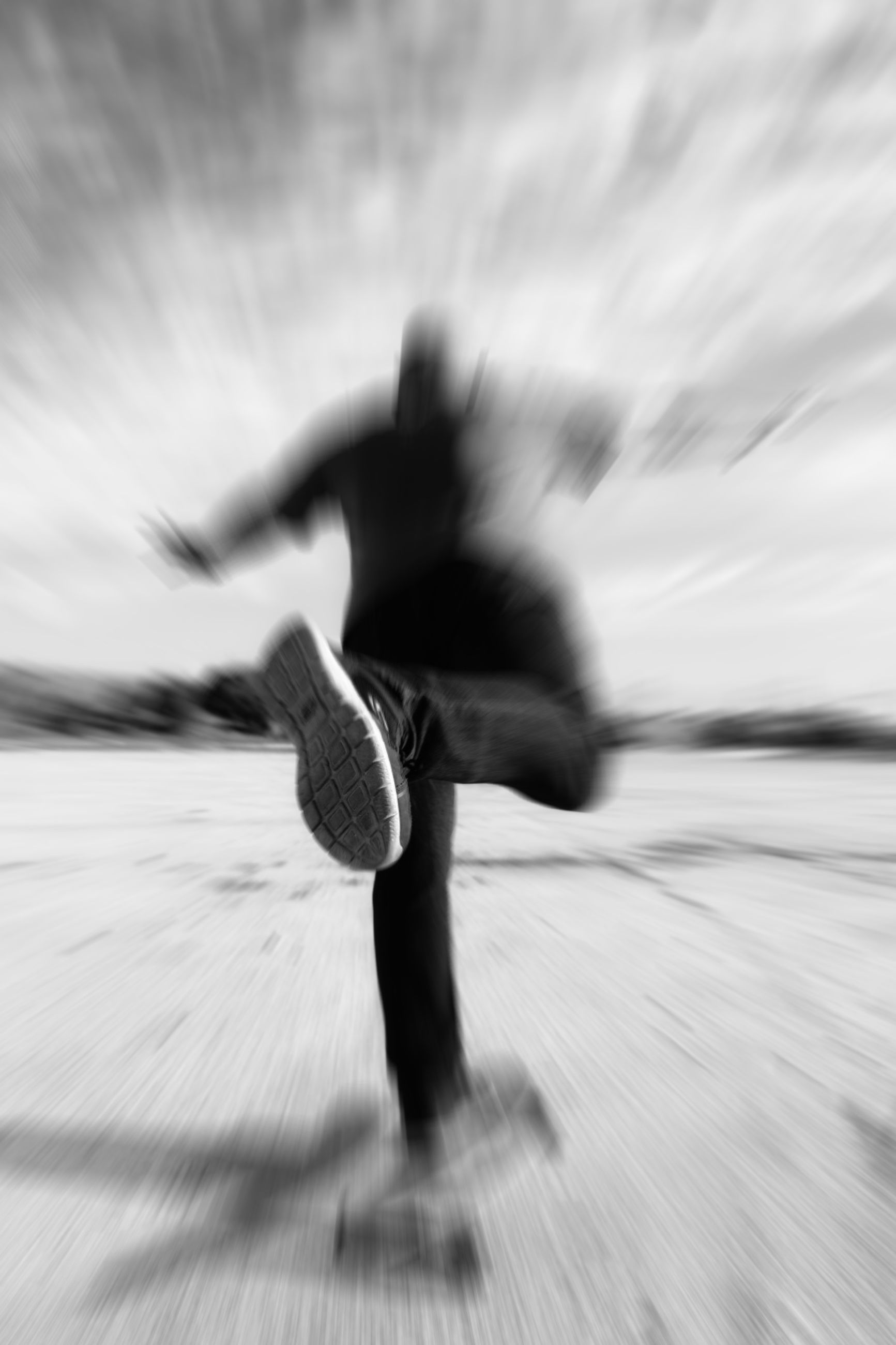 blurred motion, motion, real people, one person, lifestyles, selective focus, leisure activity, day, nature, defocused, dancing, speed, outdoors, low section, side view, unrecognizable person, sky, skill, running