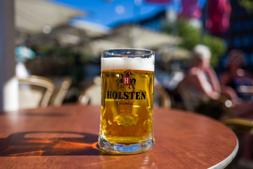 Holsten Beer Alcohol Bar - Drink Establishment Beer Beer - Alcohol Beer Glass Business Close-up Drink Drinking Glass Focus On Foreground Food And Drink Freshness Frothy Drink Glass Household Equipment Incidental People Pint Glass Refreshment Restaurant Still Life Table Wood - Material