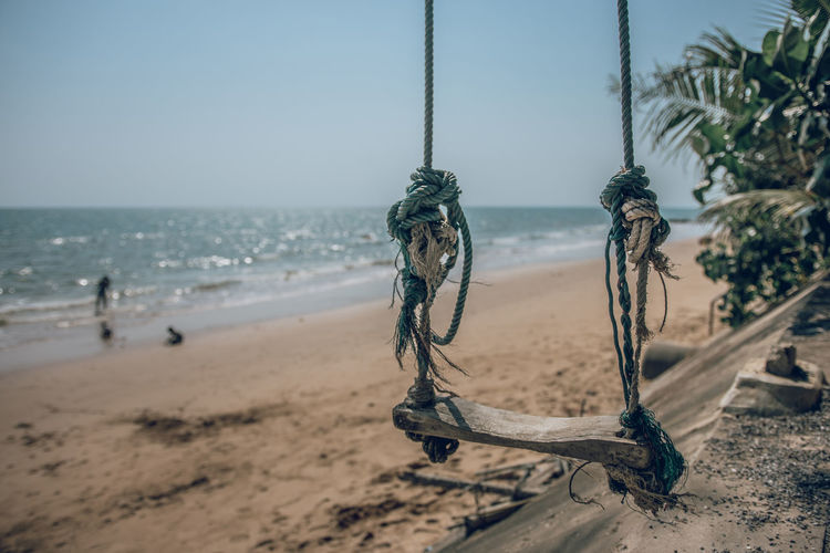 Abandoned rope swing hanging at beach