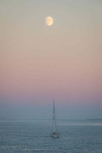Sky Sea Nautical Vessel Horizon Over Water Moon Sailboat Horizon Transportation Water Scenics - Nature Mode Of Transportation Sunset Sailing Nature Tranquil Scene Beauty In Nature Tranquility No People Dusk Outdoors Full Moon Yacht Moon