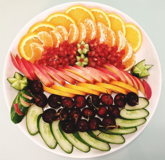 Plate with fruits Healthy Lifestyle Colorful Promegranate Mandarin Oranges Cherry Cucumber Apple Orange Fruit SLICE Close-up Sweet Food Food And Drink Serving Size