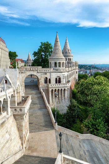 View of the amazing Fishermans Bastion in Budapest, Hungary Budapest Hungary Europe Travel Travel Destinations Tourism Buda Pest Fishermans Bastion Fishermans Bastion Halászbástya Cityscape Architecture Built Structure Day No People Building Sky Nature City Cloud - Sky Staircase Stairway Tower