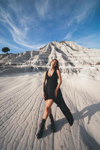 Full length of woman on arid landscape
