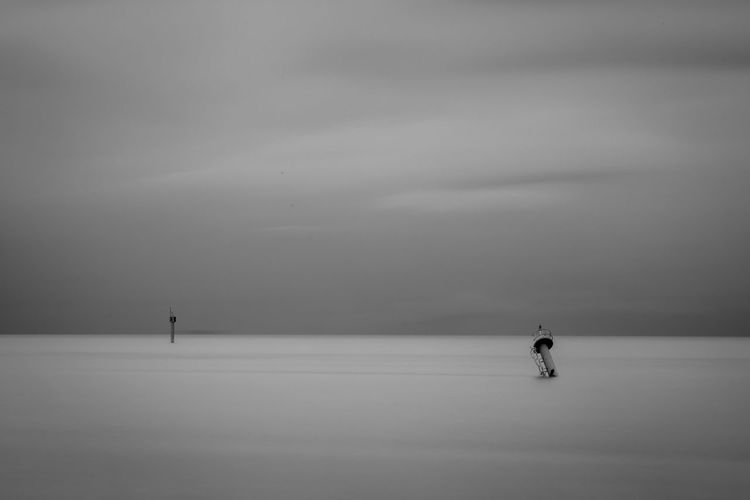 A minimalism photo of a beacon in black and white long exposure photography Alone Beacon Seascape Photography Beauty In Nature Black And White Day Fallen Fallen Beacon Fog Long Exposure Minimalism Nature Scenics - Nature Sea And Sky Silent Silent Moment Sky Standing Alone Tranquil Scene Tranquility Water