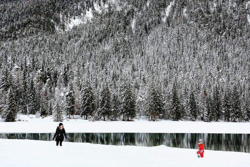 on lake Lake Ice Full Length Snow Men Sky Snowing Snowfall Snowball Deep Snow